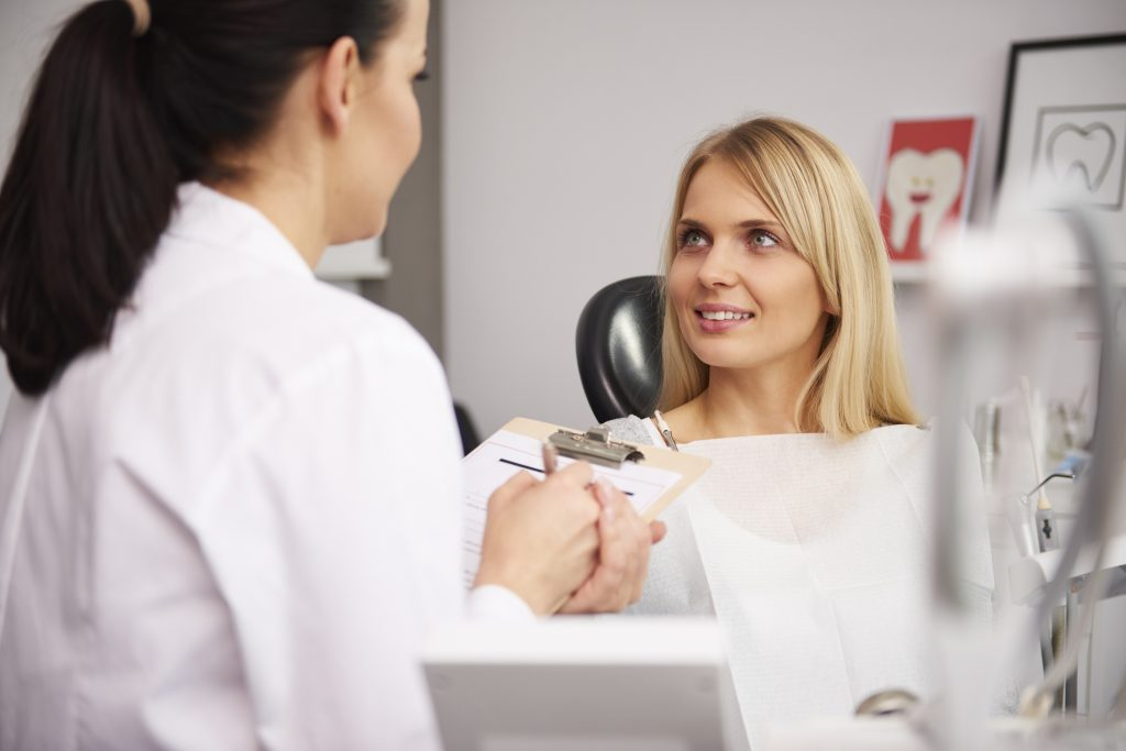 Dentist and patient discussing some medical record